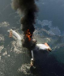 In an April 21, 2010, file photo, the Deepwater Horizon oil rig burns after a deadly explosion in the Gulf of Mexico.
