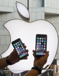 Two new iPhones are photographed at the Apple store in the center of Munich, Germany, Friday, Sept. 19, 2014.