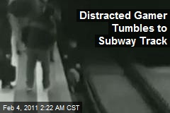 Distracted Boy Gamer Tumbles to Subway Track