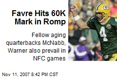 Favre Hits 60K Mark in Romp