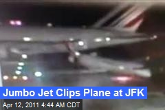Jumbo Jet Clips Plane at JFK