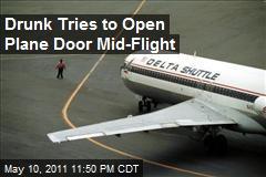Drunk Tries to Open Plane Door Mid-Flight
