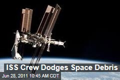 International Space Station: Crew Boards Escape Pods Because of Space Debris