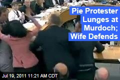 Protester Goes After Rupert Murdoch With Foam Pie as Wife Wendi Deng Defends Him