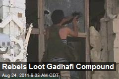 Rebels Loot Gadhafi Compound