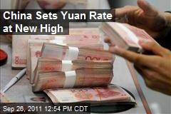 China Sets Yuan Rate at New High