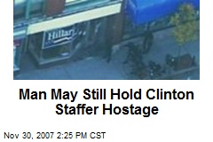 Man May Still Hold Clinton Staffer Hostage