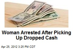 Woman Arrested After Picking Up Dropped Cash