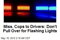 Miss. Cops to Drivers: Don't Pull Over for Flashing Lights