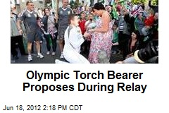 Olympic Torch Bearer Proposes During Relay