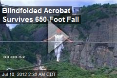 Blindfolded Chinese Acrobat Survives 650-foot Fall