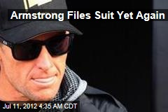 Armstrong Files Suit Yet Again