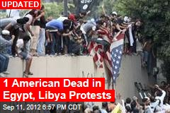 Egyptian Protesters Scale US Embassy, Destroy Flag