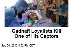 Gadhafi Loyalists Kill One of His Captors