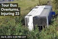 Tour Bus Overturns, Injuring 23