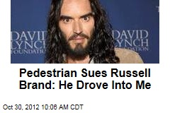 Pedestrian Sues Russell Brand: He Drove Into Me