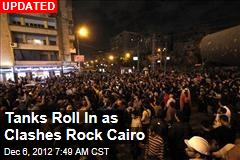 Tens of Thousands Clash in Cairo