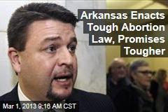 Arkansas Enacts Tough Abortion Law, Promises Tougher