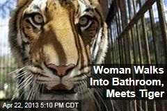 Woman Walks Into Bathroom, Meets Tiger