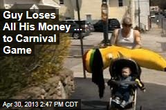 Guy Loses All His Money ... to Carnival Game