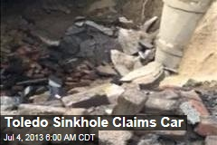 Toledo Sinkhole Claims Car