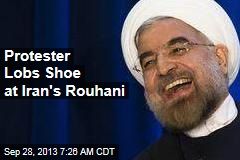 Protester Lobs Shoe at Iran's Rouhani