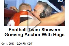 Football Team Showers Grieving Anchor With Hugs