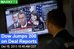 Dow Jumps 200 on Deal Reports