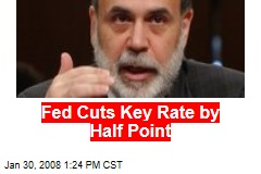Fed Cuts Key Rate by Half Point