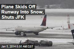 Plane Skids Off Runway Into Snow, Shuts JFK