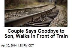 Couple Says Goodbye to Son, Walks in Front of Train