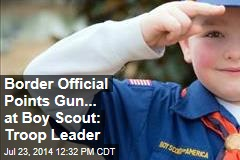 Border Official Points Gun... at Boy Scout