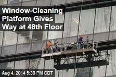 Window-Cleaning Platform Dangles at 48th Floor