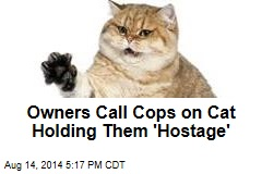 Owners Call Cops on Cat Holding Them 'Hostage'