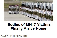 Bodies of MH17 Victims Finally Arrive Home