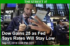 Dow Gains 25 as Fed Says Rates Will Stay Low
