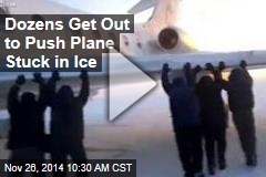 Dozens Get Out to Push Plane Stuck in Ice