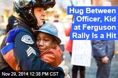 Hug Between Officer, Kid at Ferguson Rally Is a Hit