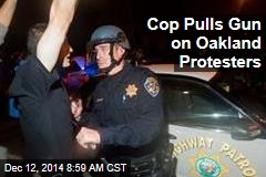 Cop Pulls Gun on Oakland Protesters