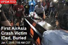 1st AirAsia Crash Victim IDed, Buried