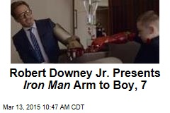 Robert Downey Jr. Presents Iron Man Arm to Boy, 7