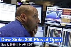 Dow Sinks 300-Plus at Open