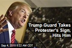Trump Guard Takes Protester's Sign, Hits Him