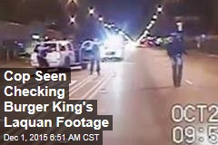 Cop Seen Checking Burger King's Laquan Footage