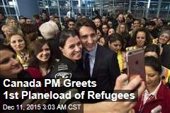 Canada PM Greets 1st Planeload of Refugees