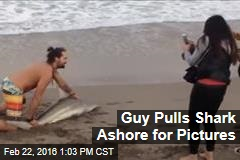 Guy Pulls Shark Ashore for Pictures