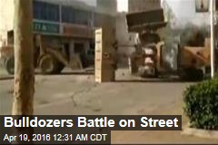 Bulldozers Battle on Street