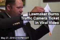 Lawmaker Burns Traffic Camera Ticket in Viral Video