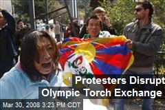 Protesters Disrupt Olympic Torch Exchange