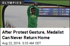 After Protest Gesture, Medalist Can Never Return Home